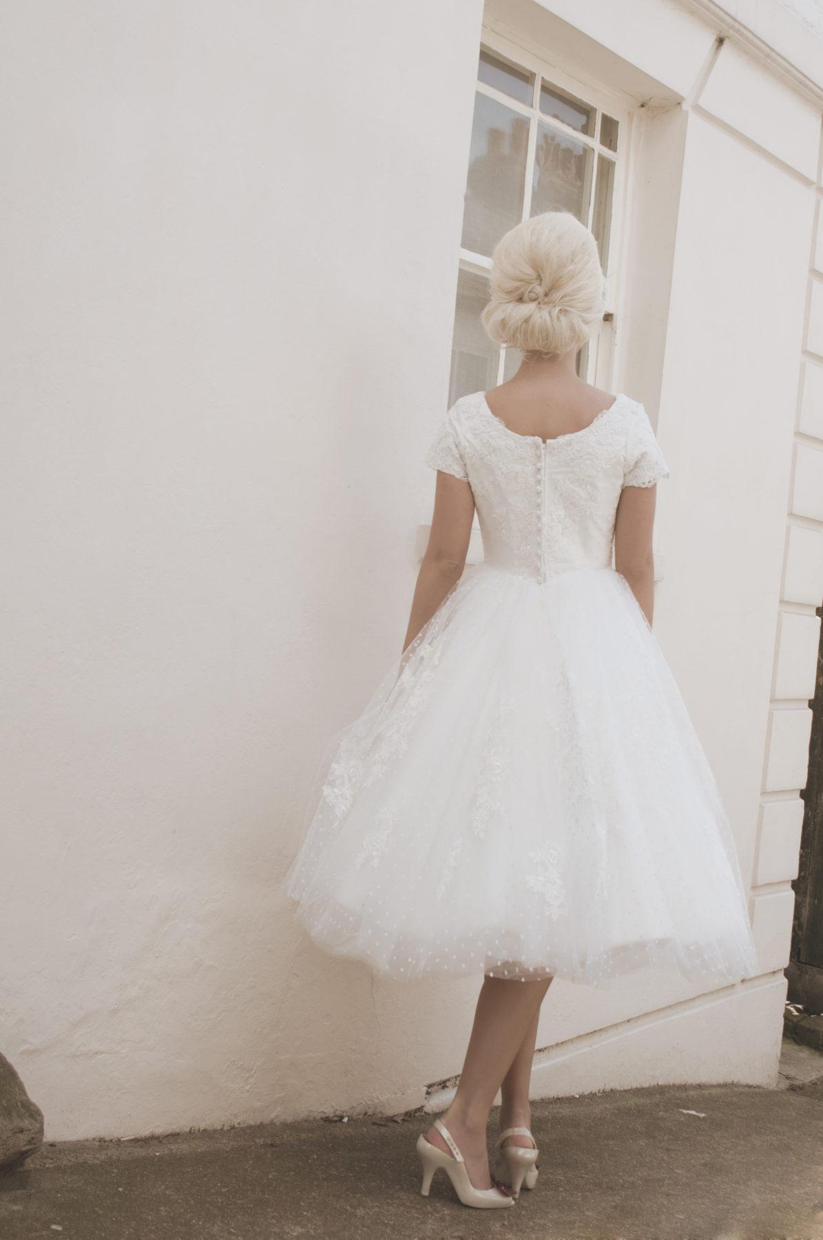 spot tulle tea length bridal gown